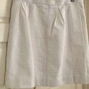 White mini skirt with lace stripes